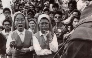 people power revolution on EDSA with nuns praying Rosary