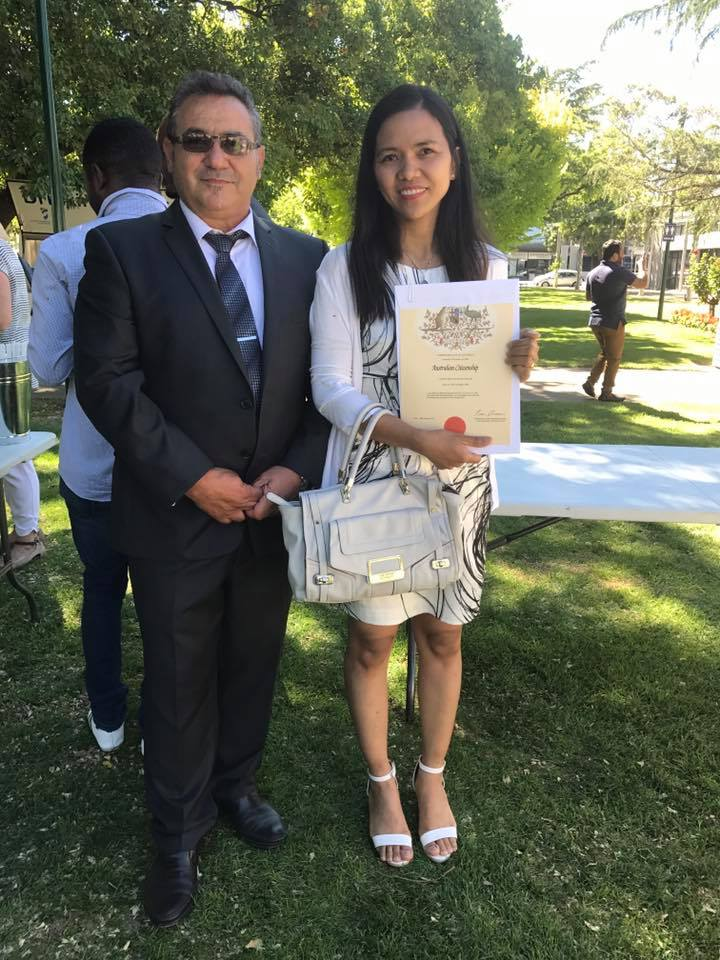 Filipina becoming an Aussie at a citizenship ceremony